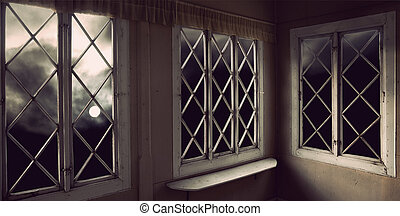 Moody sky through windows - moody creepy sky with moon seen...