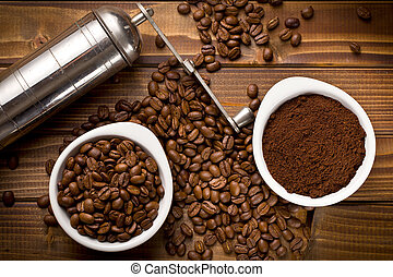 coffee beans with ground coffee and grinder - top view of...