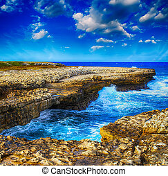 Gorgeous rocks on the coastline. Ocean view with colourful sky