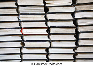 books pile - many black books rows only  one is red