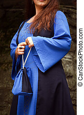 medieval woman suit - woman wearing medieval blue dress and...