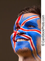 Painted face with English Flag. Big smile on background