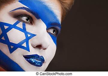 Girl with Face art. Israel flag painted on a face.