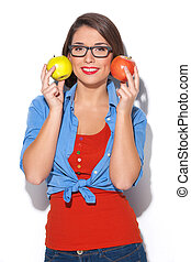 Woman with apples. Beautiful young woman holding apples near face and smiling while isolated on white