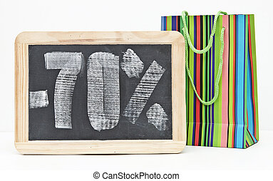 seventy percent discount written on blackboard with colorful...