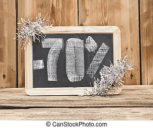 seventy percent discount written on blackboard