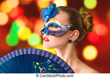 Beautiful young woman in venetian carnival mask
