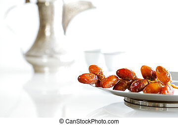 Arabic dates on a plate - Arabic dates on a white plate with...