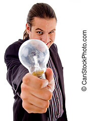 young male holding electric bulb