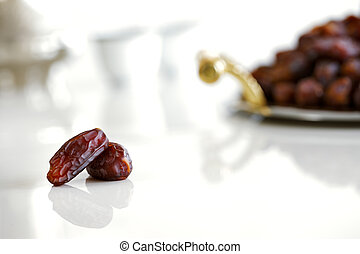 Dried dates and Arabic coffee are a prominent feature of the...
