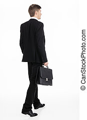 Businessman carrying a briefcase - Adult businessman...