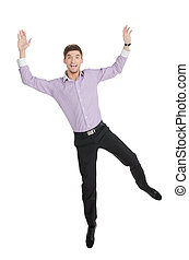 Exhilarated Young Man Jumping - Isolated - Full length of an...
