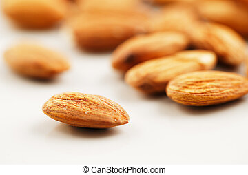 A handful of almonds on white