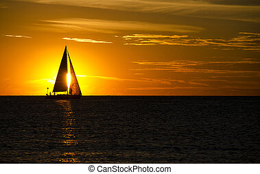 sailboat at sunset - Silhouette of a sailboat at sunset time...