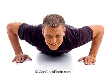smiling male doing push ups with white background