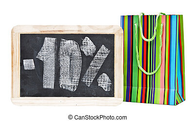 Ten percent written on blackboard with colorful shopping bag