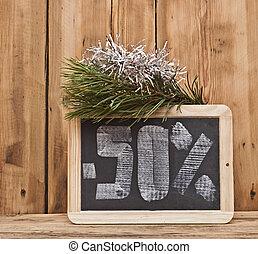 fifty percent discount written on blackboard