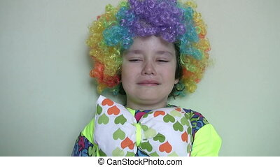 Little clown crying