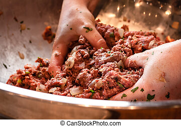 Stir Cooking School - Pair of hand mixing raw ground beef...