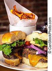 Stir Cooking School - Gourmet cheeseburger with toppings on...