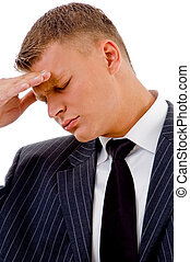 businessman holding head in tension