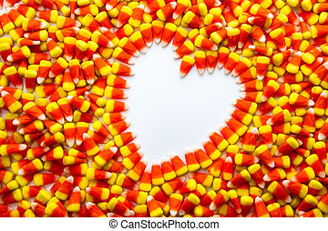 Candy Corn - Background of candy corn with heart shape