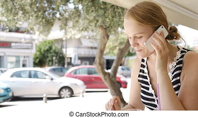 Woman eating refreshments and using a mobile