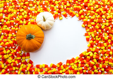 Candy Corn - Orange and white pumpkins in white square on...