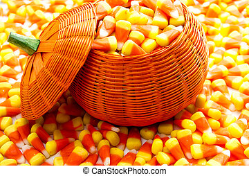 Candy Corn - Orange pumpkin wicker basket fill with candy...
