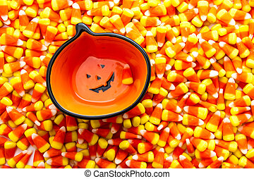 Candy Corn - Jack-o-lantern bowl sitting on candy corn...