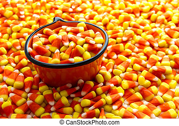 Candy Corn - Orange pumpkin bowl filled with candy corn...