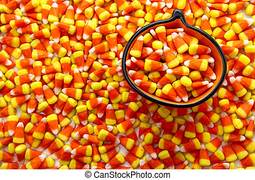 Candy Corn - Pumpkin bowl filled with candy corn candies