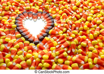 Candy Corn - Indian corn arranged in heart shape among candy...
