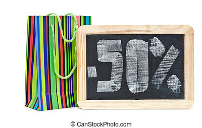fifty percent written on blackboard with colorful shoping...