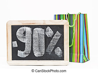 ninety percent discount written on blackboard with colorful...