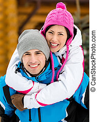 Young couple having fun during winter holidays - Portrait of...
