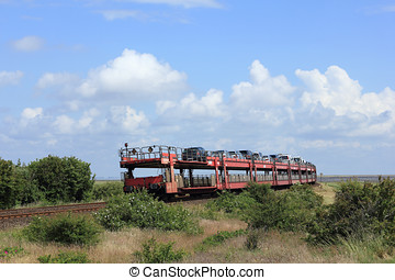 The Car shuttle train leaves the Island of Sylt - The...