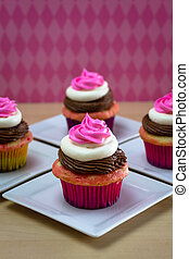 Neapolitan Cupcakes - Neapolitan frosted cupcakes on small...