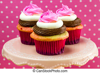 Neapolitan Cupcakes - 3 neapolitan frosted cupcakes on pink...