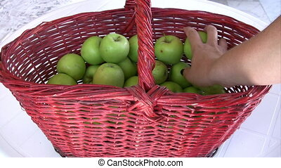 Green apple in the basket