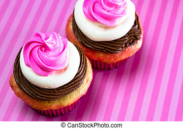 Neapolitan Cupcakes - Neapolitan frosted cupcakes on pink...