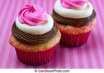 Neapolitan Cupcakes - 2 neapolitan frosted cupcakes sitting...