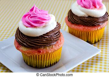 Neapolitan Cupcakes - Neapolitan frosted cupcakes on white...