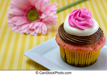 Neapolitan Cupcakes - Single neapolitan frosted cupcake on...