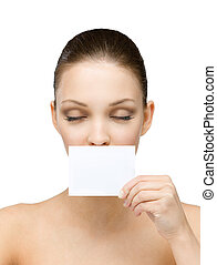 Naked girl keeps copyspace card in front of her mouth - Nude...