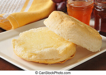Hot buttermilk biscuits with peach and strawberry jams