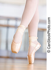 Close-up of dancing legs of ballerina in pointes - Close-up...