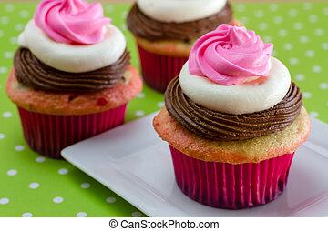 Neapolitan Cupcakes - 3 neapolitan frosted cupcakes on white...