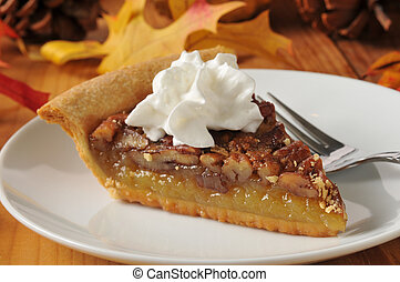 Pecan pie with whipped cream - Pecan pie topped with whipped...