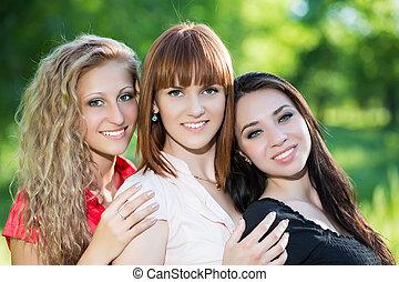 Three cheerful women - Portrait of three cheerful women...